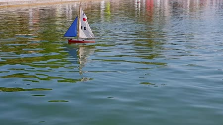 The ships model floats in the water .