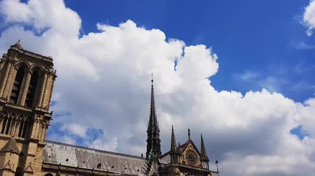 Cumulus clouds over the roof of the Cathedral of Our Lady of Paris