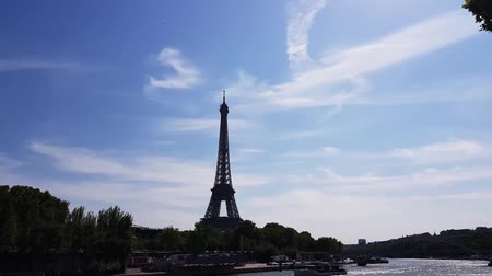 Eiffel Tower and ships in Paris France. Stock Footage
