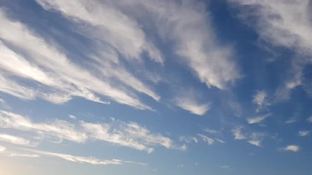 Time lapse of white clouds moving fast Stock Footage