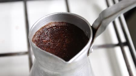 alumínium : Close up of cezve with aromatic coffee is prepared on the stove
