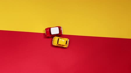 Small yellow and red background, top view. Concept of crash, race or victory in competitions Стоковые видеозаписи
