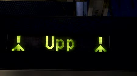 Electronic board with arrows in the subway. Animations of yellow arrows going up on a LED panel