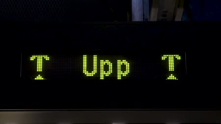 eight : Up sign. Electronic board with arrows in the subway. Animations of yellow arrows going up on a LED panel