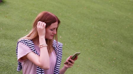 tárcsázás : Young blonde girl using smartphone voice recognition, dictation thoughts