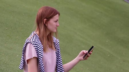 Young girl using smartphone texting on social media browsing online