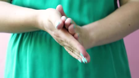 mimos : Clean well-groomed hands of a young woman applying hand cream, skin care. Female hands smear body cream. Skin Care Chen Health