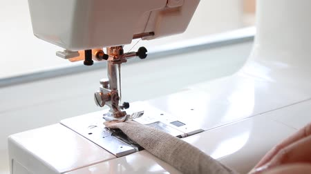 hímzés : Close up on a sewing machine showing process. Small business clothing production concept.