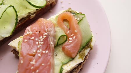 majonez : Open sandwich with fish and vegetables with pink ceramic plate Selective focus
