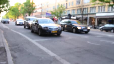 célere : Different cars drive down the street and stop in front of the pedestrian crossing. Vehicles in the city Vídeos