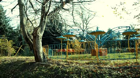 Old abandoned colorful attractions in the old park