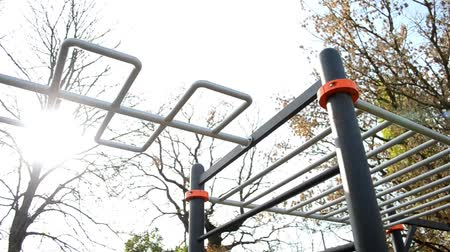 Modern crossbar for sports and athletics and workout in village outdoors