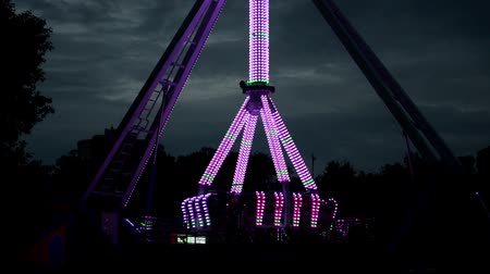 Extreme attraction in lunapark, change color, colorful, has not yet started Stock mozgókép