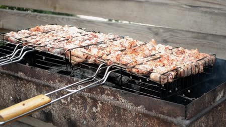 Chicken appetizing meat is fried on the grill