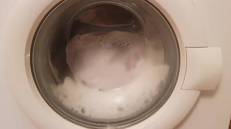 lavanderia : Reel of washing machine with foam turns