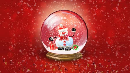 neve : Christmas background. Animation of Snowman happy waving inside of snow globe. Crystal snowball against red background and falling snow