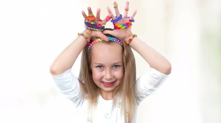 ostoba : Loom bands craft. Little girl demonstrating her works.