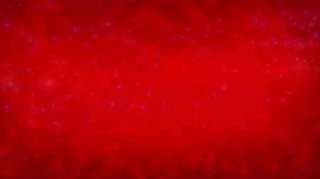 vago : Animation of defocused flowing light dots on red background. Christmas background
