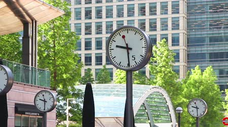 docklands : Modern architecture of Canary Wharf and clocks on the main square