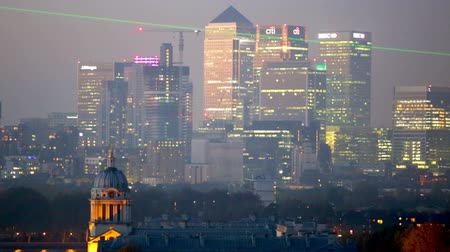 london england : LONDON, UK - OCTOBER 31, 2015: Canary Wharf night panorama. View includes Royal chapel and Painted hall in Greenwich
