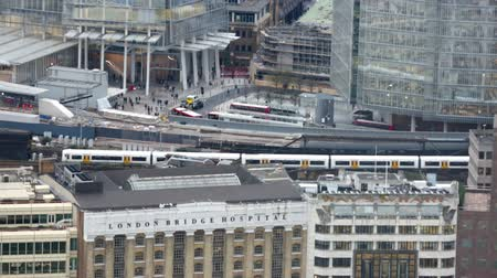 LONDON, UK - NOVEMBER 4, 2015:  London bridge train station with running trains and lots of people