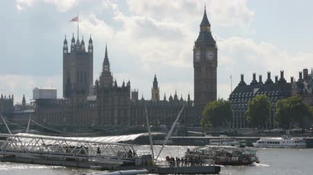 LONDON, UK - SEPTEMBER 20, 2015: Big Ben and houses of parliament. View from river Thames.