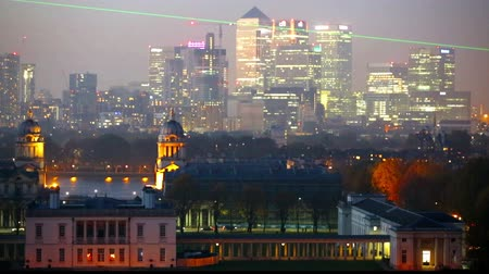 greenwich : LONDON, UK - OCTOBER 31, 2015: Canary Wharf night view with painted hall and Royal chapel Stock Footage