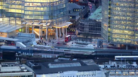 panoramic view : LONDON, UK - NOVEMBER 4, 2015: Night view London Bridge train station. View from the 35th floor includes lit up office buildings