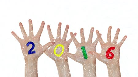 Childrens hands raising up with painted 2016 year Vídeos