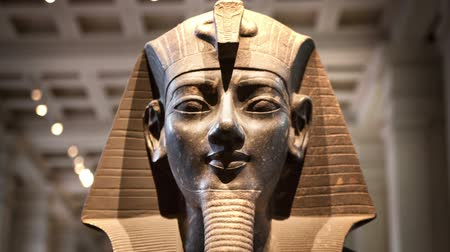 aswan : LONDON, UK - NOVEMBER 30, 2014: British museum Egyptian sculpture hall, Pharaoh Rameses Stock Footage
