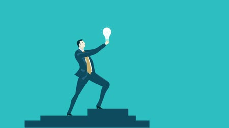 Businessman staying on top of the stairs and raising up the light bulb as symbol of idea and innovation