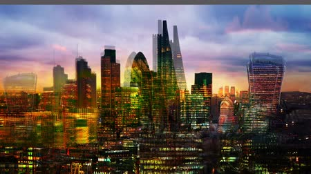 City of London at night. Multiple exposure image includes City of London financial aria at sunset