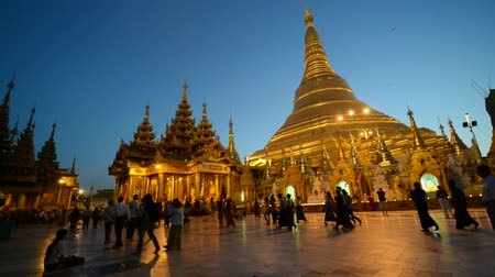 shwezigon : YANGON, MYANMAR - 03 Jan 2014 : Burmese pilgrims visit Shwedagon Pagoda in evening dark. This pagoda is the most sacred Buddhist pagoda for the Burma.