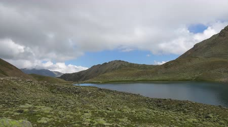 gizemli : Time lapse lake scenes in mountains, national park Dombai, Caucasus, Russia, Europe. Summer landscape, sunshine weather, blue sky and sunny day Stok Video