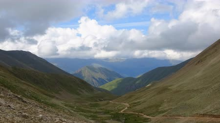 inspiráló : Time lapse mountains in the national park Dombai, Caucasus, Russia, Europe. Summer landscape, sunshine weather, blue sky and sunny day Stock mozgókép