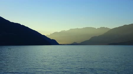 inspiráló : Time lapse view Lake Thun (Thunersee) and mountains of Swiss Alps in the city of Spiez, Switzerland, Europe. Summer landscape, sunshine weather, blue sky and sunny day