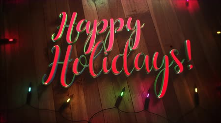 holidays : Animated closeup Happy Holidays text and colorful garland on wood background. Luxury and elegant dynamic style template for winter holiday