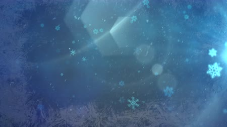 blinks : Abstract blue bokeh and snowflake falling. Happy New Year and Merry Christmas shiny background. Luxury and elegant dynamic style template for winter holiday Stock Footage