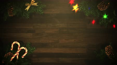 blinks : Animated closeup colorful garland and Christmas green tree branches on wood background. Luxury and elegant dynamic style template for winter holiday