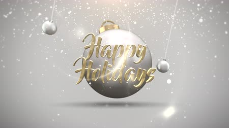 glowing balls : Animated closeup Happy Holidays text, motion balls and snowflakes on white background. Luxury and elegant dynamic style template for winter holiday Stock Footage