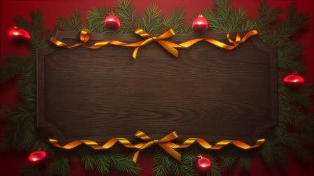glorious : Animated close up red balls and Christmas green tree branches on wood background. Luxury and elegant dynamic style template for winter holiday Stock Footage