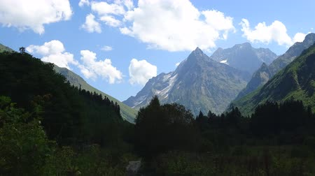 serenidade : Time lapse mountains scene in national park of Dombay, Caucasus, Russia, Europe. Summer landscape, sunshine weather, blue sky and sunny day
