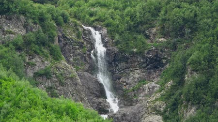 inspirar : View waterfall scenes in mountains, national park Dombai, Caucasus, Russia. Summer landscape, sunshine weather and sunny day Stock Footage
