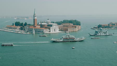 адриатический : Venice, Italy - June 30, 2018: Panoramic view of San Giorgio Maggiore Island from St. Marks Campanile. Landscape of summer day and sunny blue sky