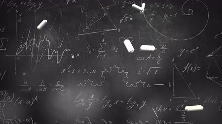 hesaplama : Closeup mathematical formula and elements on blackboard, school background. Elegant and luxury animation footage of education theme Stok Video