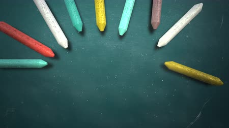 vonalvezetés : Closeup colorful chalk on blackboard, school background. Elegant and luxury animation footage of education theme