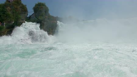 roaring : View of waterfall the Rhine Falls (Rheinfalls) in Schaffhausen, Switzerland. The Rhine Falls is the largest waterfall in Europe. Summer landscape and sunny day Stock Footage