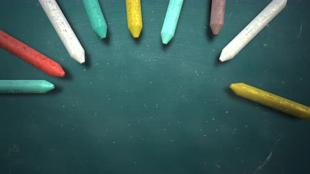 мел : Closeup colorful chalk on blackboard, school background. Elegant and luxury animation footage of education theme