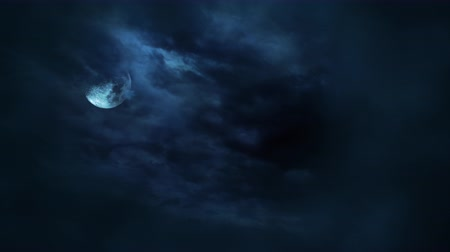 holdfény : Mystical animation halloween background with dark moon and clouds. Holiday abstract backdrop. Luxury and elegant dynamic animation footage of halloween theme