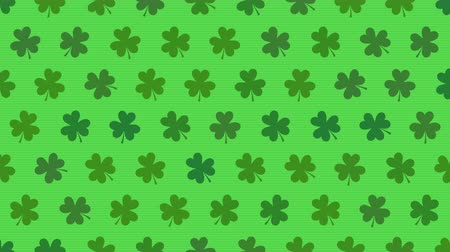 st patrick : Motion green shamrocks, Saint Patricks Day animation background. Luxury and elegant dynamic style template for holiday Stock Footage